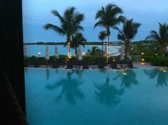 Grand Isle Resort & Spa: Pool during evening- tiki torches!