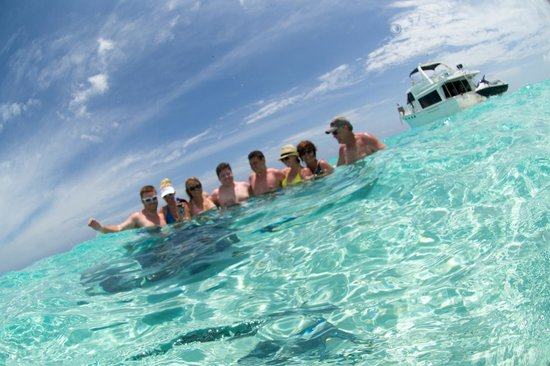 Cayman Private Charters: Family Shot with Rays all around