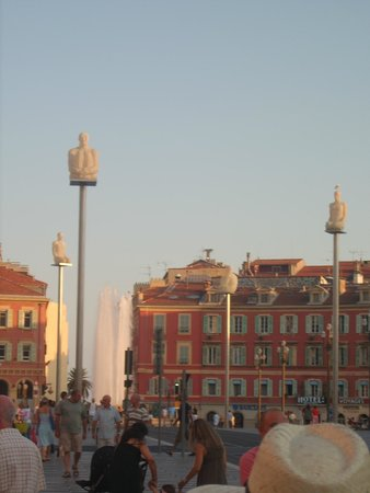 Place Massena: the statues are colored by night
