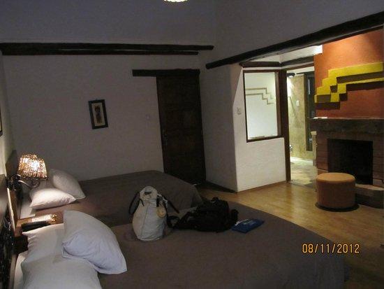 Hatun Inti Boutique Machupicchu: quarto com lareira