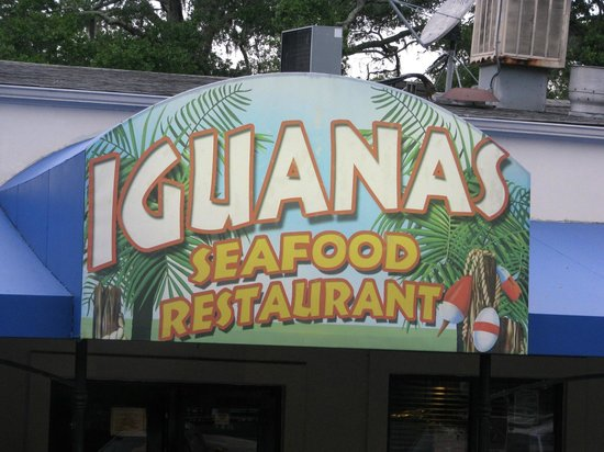 Iguanas Seafood Restaurant: decorated sign outside