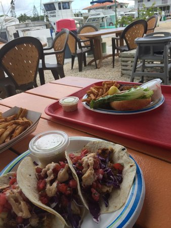 Key Largo Fisheries Backyard: Grilled mahi fish tacos and snapper sandwich. Nice view!