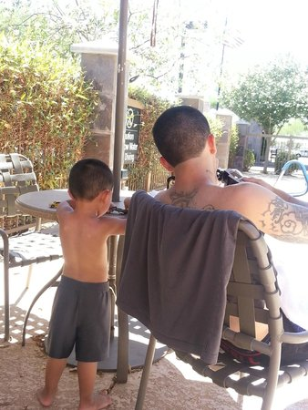 Hampton Inn & Suites Phoenix North/Happy Valley : Father and son time at poolside.