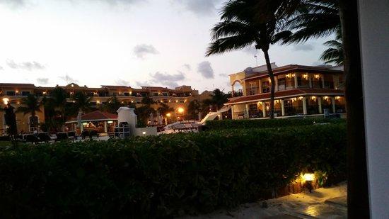 Secrets Capri Riviera Cancún: View of resort from beach at night