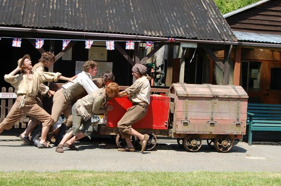 Poldark Mine: BBC crew pushing the explosives waggons at Poldark
