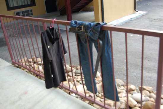 Country Town N' Suites : somebodys clothes hanging outside the room