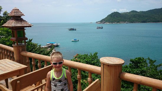Santhiya Koh Phangan Resort & Spa: My son enjoying the view from the restaurant.