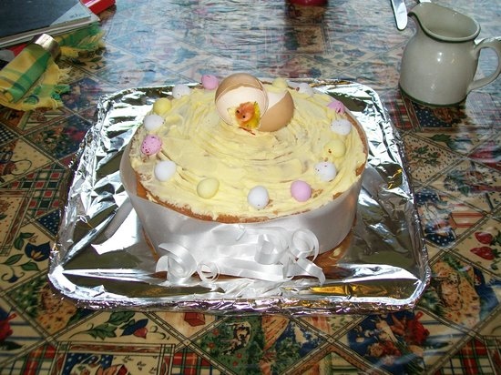 Riverfield Farmhouse: a very clever and delicious Easter cake, decorated with chick, eggshell, and ribbon