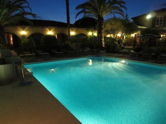 Hôtel La Garbine : poolside at dusk