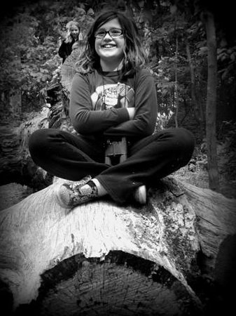 Runge Conservation Nature Center: sitting on a log