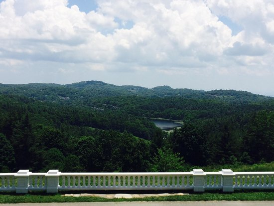 Flat Top Manor: The view from Moses H. Cone Manor of Bass Lake as well as the Blue Ridge Mountains in the distan