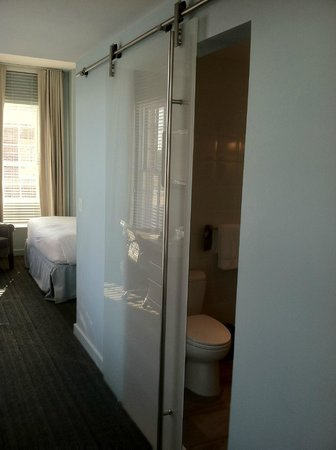 Lorien Hotel and Spa, a Kimpton Hotel : The beautiful bathroom door that doesn't close all the way..