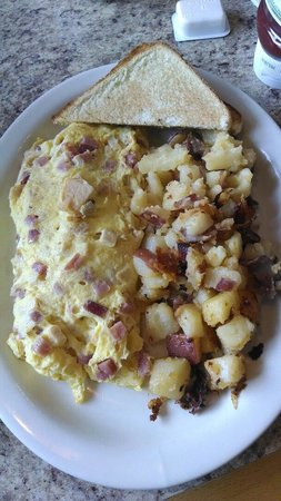 Chicken cordon blue omelet with home fries and toast. YUM!