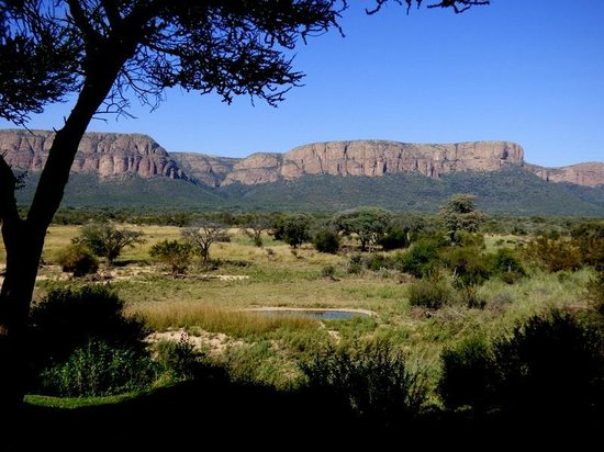 Marataba Safari Lodge - view from the main lodge of the watering hole and Waterberg Mountains