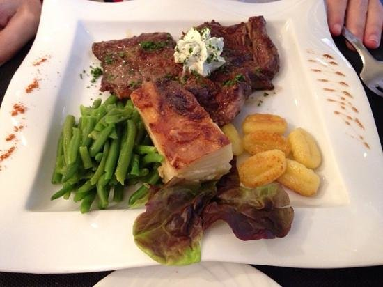 Burgerman : steak with herb butter, au gratin potato and green beans