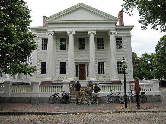 Nantucket Bike Tours: one of the houses described by the guides seen with Tina in front
