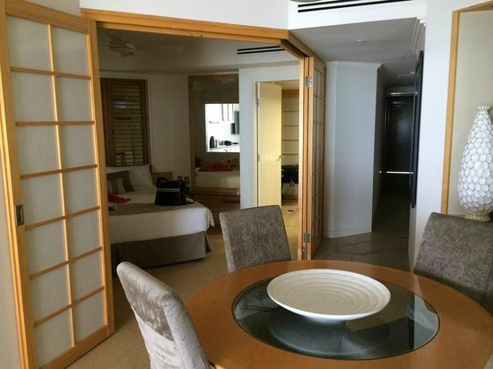 Tingirana Noosa: 2 bedroom apartment - view into the main bedroom from the dining room