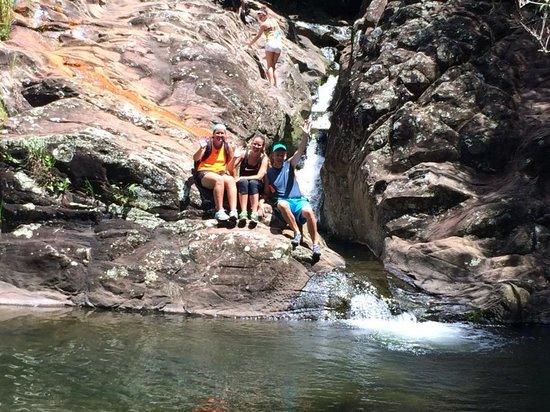 Maui Hiking Safaris Hiking Tours : Sitting near a mini waterfall