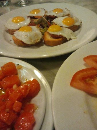 Los Coloniales : Three tapas: Carrots in dressing, quail eggs and chorizo on baguette; marinated tomatoes