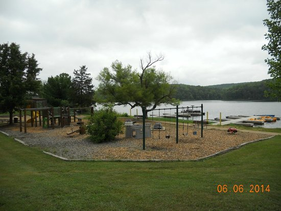 YMCA Trout Lodge : playground by boat house and campfire site