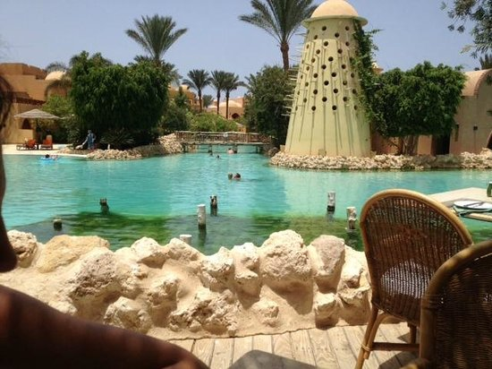 The Grand Makadi Hotel: Pool area viewed from table at Caribbean Restaurant