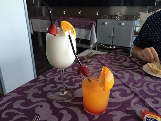 Romantica : We don't drink wine. They happily made us cocktails to our liking :) piña colada and tequila sun