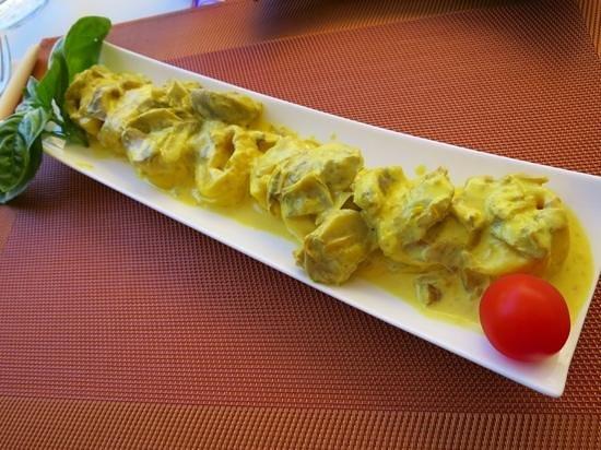 Osteria Il Gallo nel Pozzo: Homemade stuffed pasta with saffron artichoke sauce!