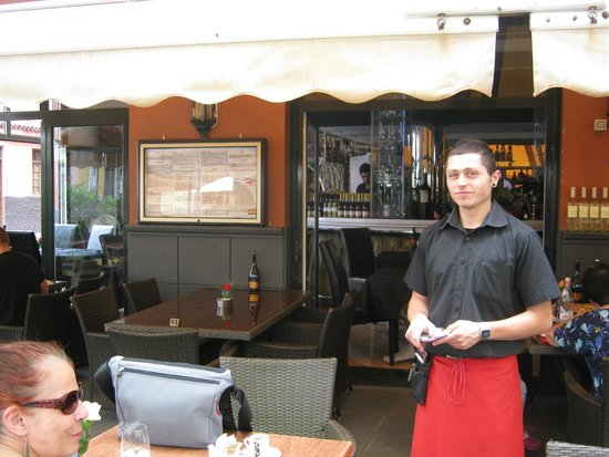 "Restaurante-Pizzeria Don Camilo : Charming young waiter whom we christened ""Chicharito""!"