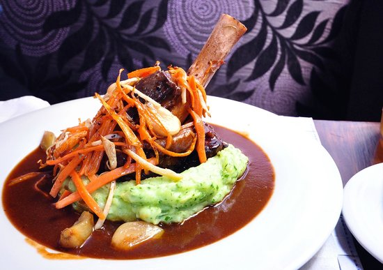 Renomme: lamb shank braised in red wine with garlic confit, roasted vegetables and mashed potatoes with h