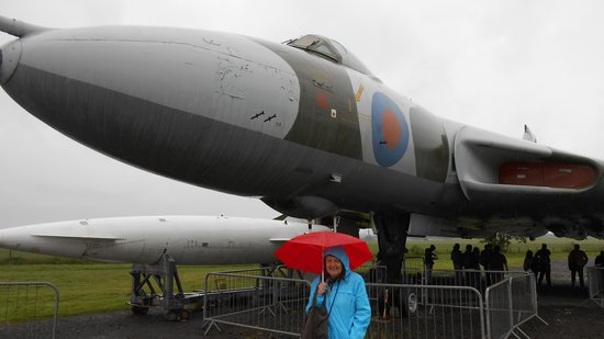 National Museum of Flight: My wife sheltering from the rain..