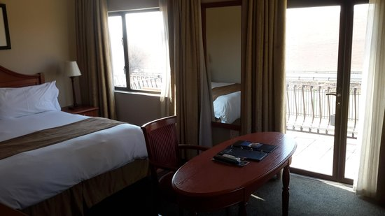 Protea Hotel by Marriott Harrismith Montrose: suite consists of King bed double sleeper couch desk and chair with tea/coffee, tv, wi-fi