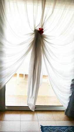Concorde Hotel Marco Polo: Our patio curtain tied with a flower in it