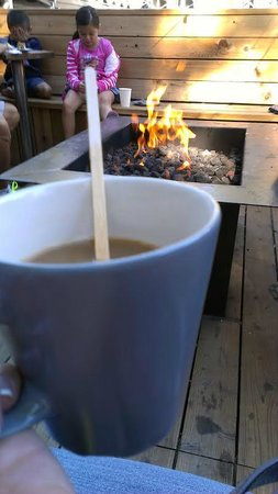 Basecamp Hotel: morning coffee + bonfire. random cute kids is bonus.