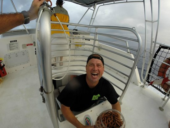 Big Island Divers : One of the dive masters come to offer some pretzels