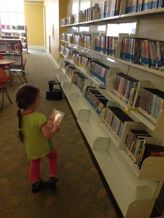 Brentwood Library: My daughter checking out the DVD selection