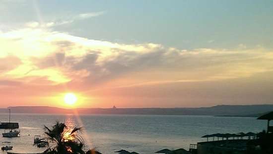 Ramla Bay Resort: Sunset from the Al Fresco Main Dining area