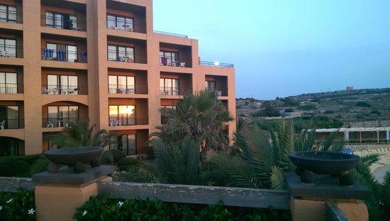 Ramla Bay Resort : Reflected sunset upto the Red Tower