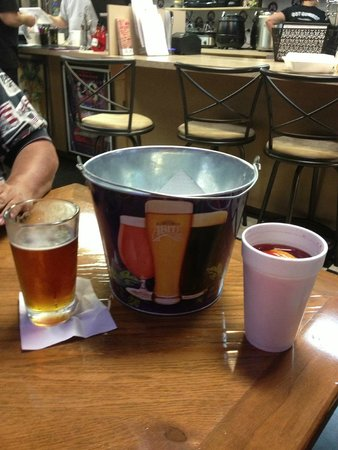 Gumbo YaYa's East : Beer, a bucket for the anticipated crab  refuse and my Hurricane.