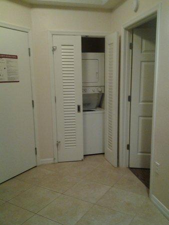 Sheraton Vistana Resort Villas- Lake Buena Vista: Foyer area. Door on left. Washer/dryer stack unit in view. First bedroom door to right