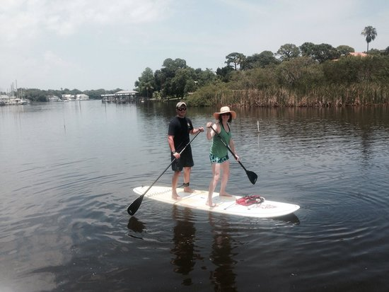 SUP Eco Adventures: Posing on a board together after a great day!