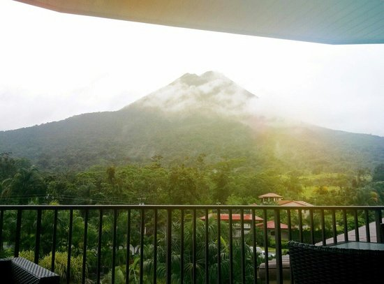 The Royal Corin Thermal Water Spa & Resort: View of the Arenal volcano from the Lava Bar balcony which is on the 5 floor of the hotel.