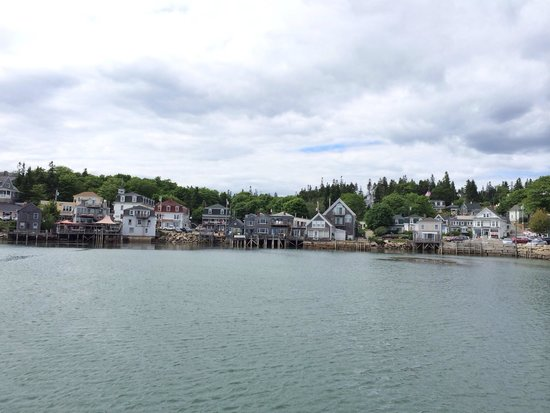 Inn on the Harbor: Out on pier looking back at Stonington. The Inn is in the middle with the vertical pier supports