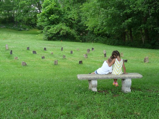 Sevierville, TN: A beautiful picture of my kids taking in all the history. Old lives were lost while new ones hav