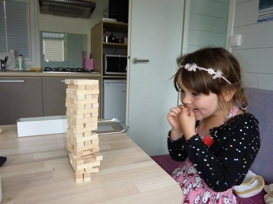 Camping Bellevue : quick game of Jenga in the nicely appointed holiday home