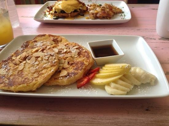 Mango Cafe: Coconut french toast w/ eggs benedict in background