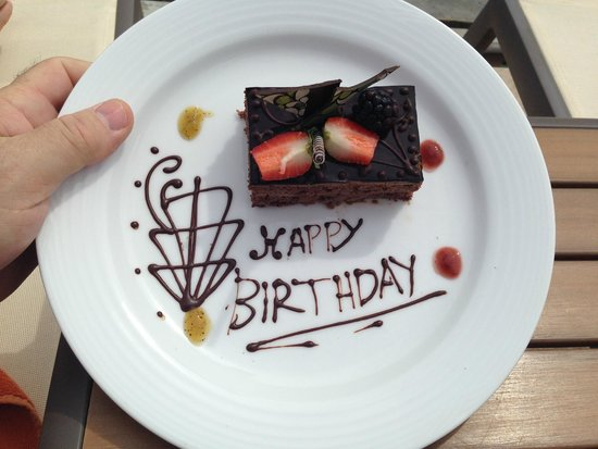 Secrets Puerto Los Cabos Golf & Spa Resort: My husband's birthday surprise delivered poolside
