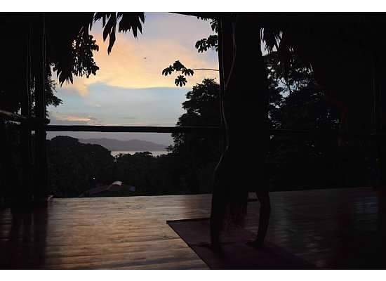 Cashew Hill Jungle Cottages: Part of yoga platform during sunset