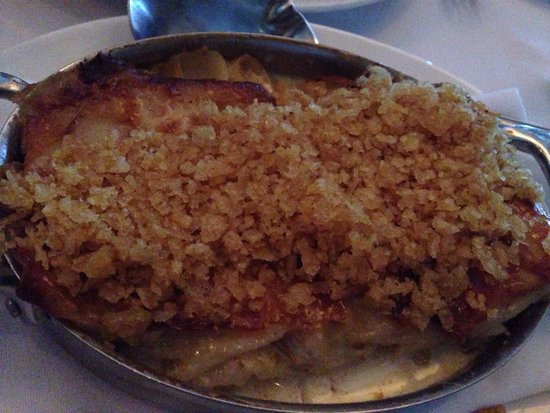 Capital Grille: Au Gratin Potatoes Hearty slices layered with a blend of cheeses. Not to be missed.