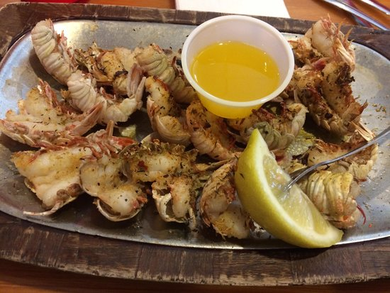 Dixie Crossroads: Broiled Rock Shrimp seasoned with garlic and jerk