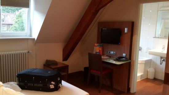 Stadthotel Freiburg Kolping Hotels and Resorts : TV and bathroom